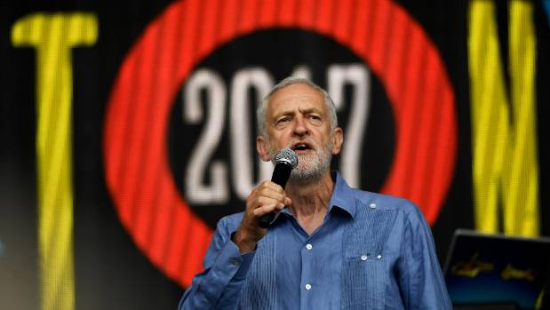 Britain's opposition Labour Party leader Jeremy Corbyn addresses revellers from the Pyramid Stage at Glastonbury.