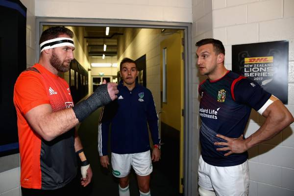 The two captains, Sam Warburton and Kieran Reid do the coin toss.