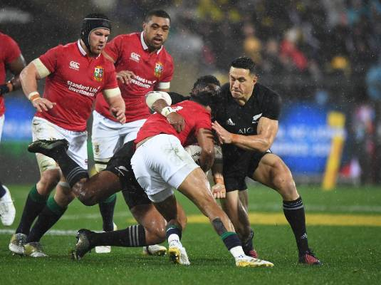 Sonny Bill Williams shoulder charges Anthony Watson.
