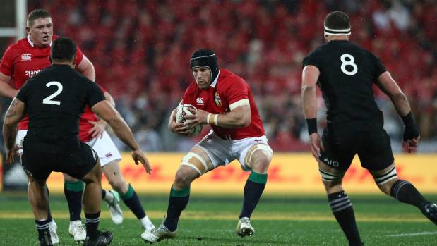 Sean O'Brien braces to take on the All Blacks line of Codie Taylor  and Kieran Read.