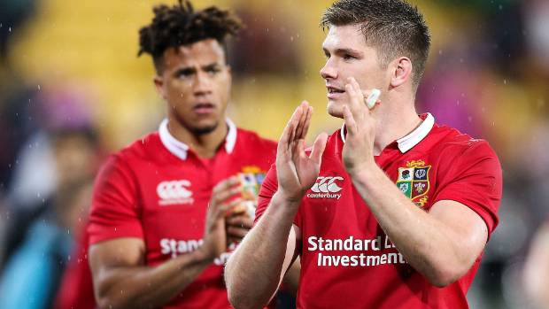 Owen Farrell of the Lions and Anthony Watson of the Lions applaud the crowd after winning second test in Wellington.