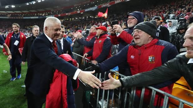 Gatland shakes Lions' fans hands after winning in Wellington.