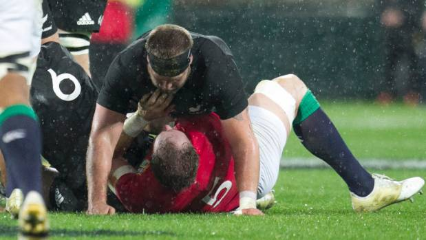 All Blacks loosehead prop Joe Moody has a quick word with Lions lock Alun Wyn Jones.