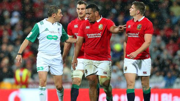 Referee Jerome Garces speaks to Lions prop Mako Vunipola during the test at the Cake Tin.