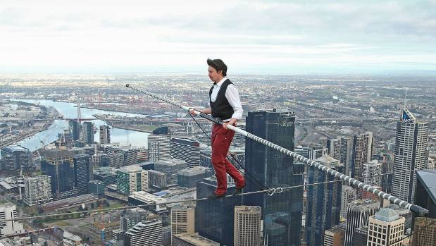 A bloke crosses a tightrope 300 metres above the ground in Melbourne, Australia. Not scary at all.