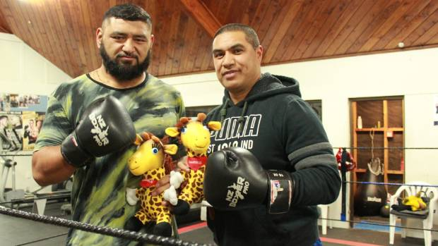 Matthew Paraha and Tamatea Puru are set to fight for the Life Education Trust. They hold Life Education mascot- Harold.