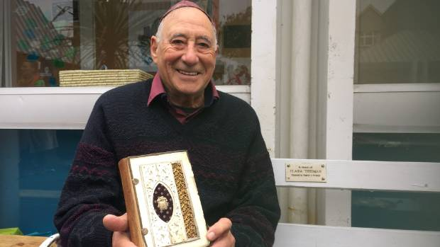 Michael Clements, president of the New Zealand Jewish Archives,  with a book of prayers for the Day of Atonement, ...