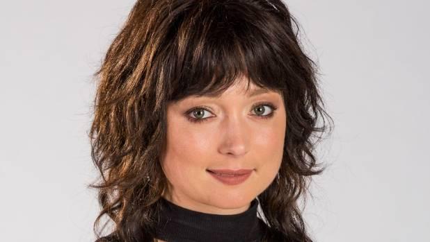 "Antonia Prebble says her Westside mullet wig ""has had a slight haircut""."