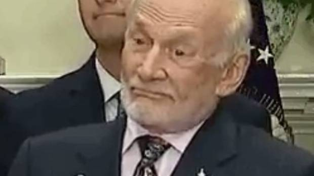 It was hard to tell what Aldrin was thinking as he reacted to Trump's speech