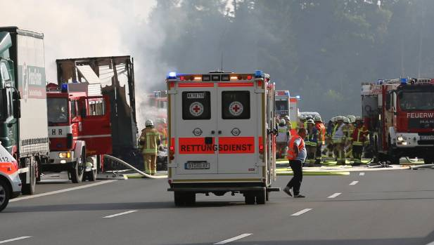 Bus bursts into flames after collision in Germany, 17 unaccounted for