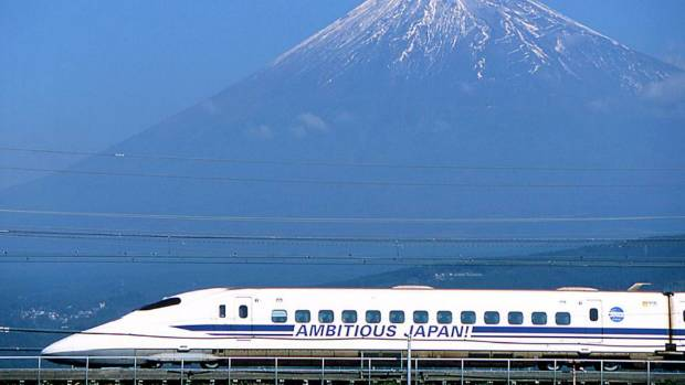 "A Japanese bullet train, or ""shinkansen"", speeds past Mount Fuji, west of Tokyo (file photo)."