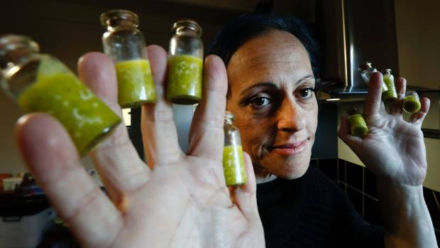 Kelly Patchett with some of the medicinal cannabis products she makes in her Nelson home for her own use to help manage ...
