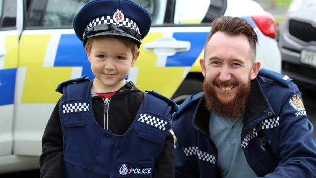 Lennox Lindsay, 5, tries on constable Jack Driver's vest for size.