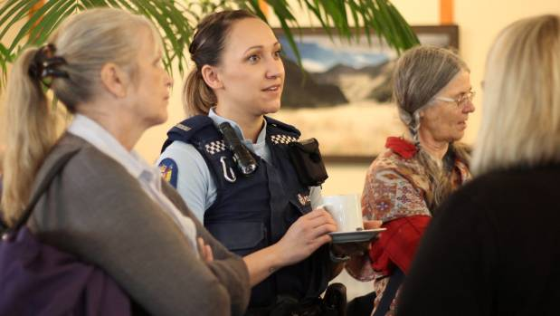 Paeroa constable Jacinda Karaitiana enjoys a cuppa while answering questions from the crowd.
