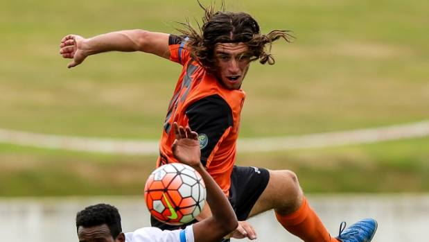 Tasman United defender Daniel Allan wins a header against Hamilton Wanderers.