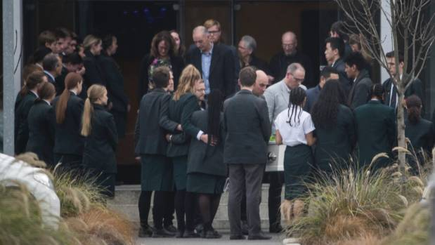 Middleton Grange students form a guard of honour as Emily White's casket was carried from La Vida Centre in Christchurch ...