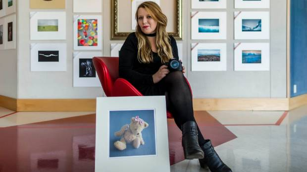 Photography student Jeni Berrett hopes to offer free family portraits to troubled families.