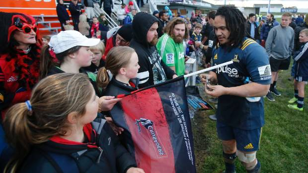 Timaru's own Aki Seiuli signs autographs for fans at Alpine Energy Stadium as the Crusaders tackled the Highlanders.