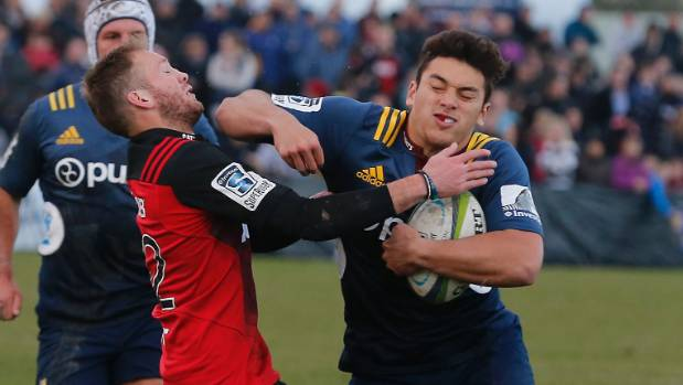 Crusaders Marty McKenzie tries to tackle Highlanders Thomas Umaga-Jensen in their clash at Alpine Energy Stadium.
