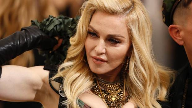 Madonna claims auction house is 'selling her DNA'