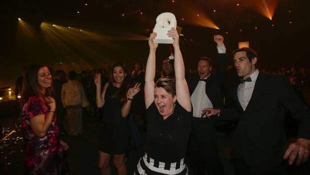 Flick Electric brand general manager Jessica Jenning-Bryan holds the Supreme Award aloft.