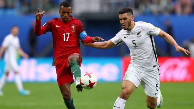 All Whites defender Michael Boxall, right, marks up against Nani of Portugal at the Confederations Cup in Russia.