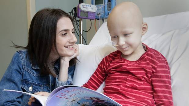 Wellington cancer patient and author Petra Kotrotsos shares her book with six year old Victoria Vysotskaya at Wellington ...