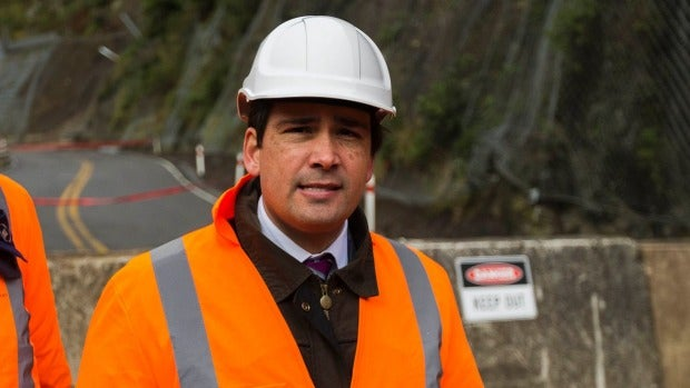 Transport Minister Simon Bridges, pictured at the Manawatu Gorge, accepts the road's closure needs a solution sorted quickly.