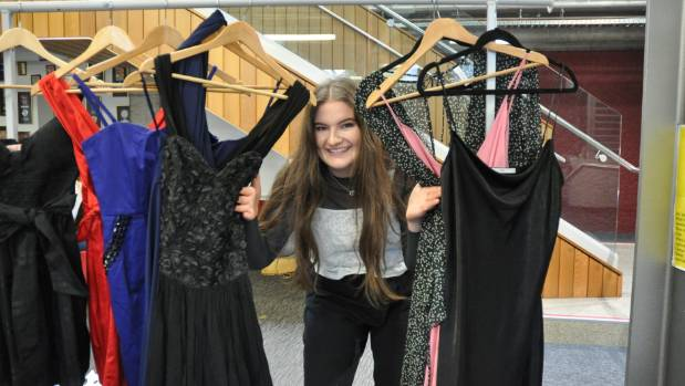 Wellington Girls College student Georgina Hasell, 17, with a selection of the dresses donated so far.