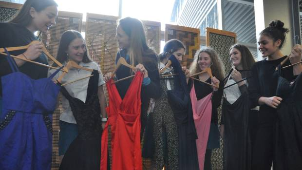 Year 12 and 13 students at Wellington Girls' College getting a sneak peak at some of the dresses that will be up for ...