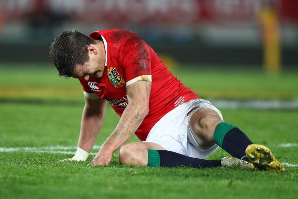 Johnny Sexton of the Lions goes down injured.