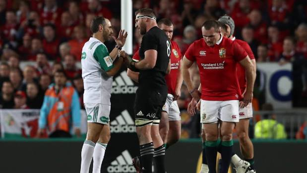 Kieran Read speaks with Referee Romain Poite, after he awards a scrum rather than a penalty in the last minute.