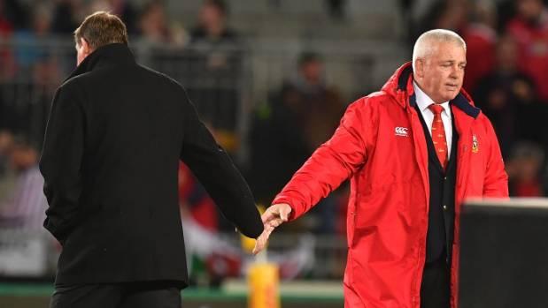 All Blacks coach Steve Hansen shakes hands with Lions coach Warren Gatland after the match.