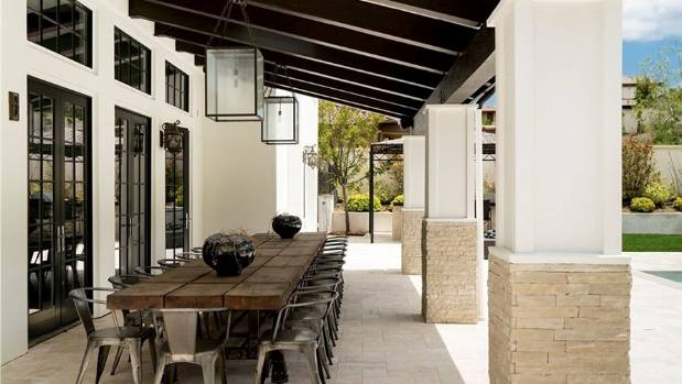 Outside, a covered loggia is ideal for poolside parties.