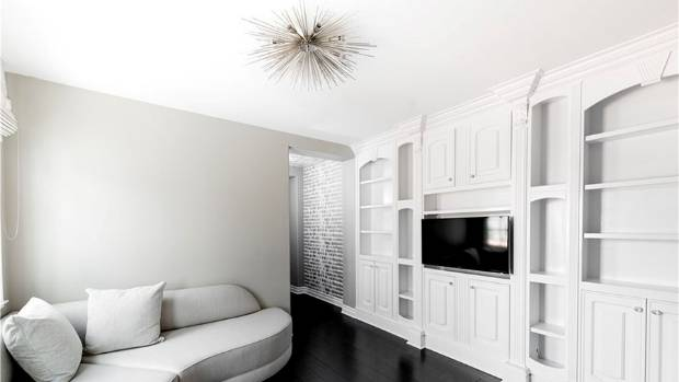 Most of the rooms have built-in cabinetry, and statement lighting. This small den is part of the master suite. The ...