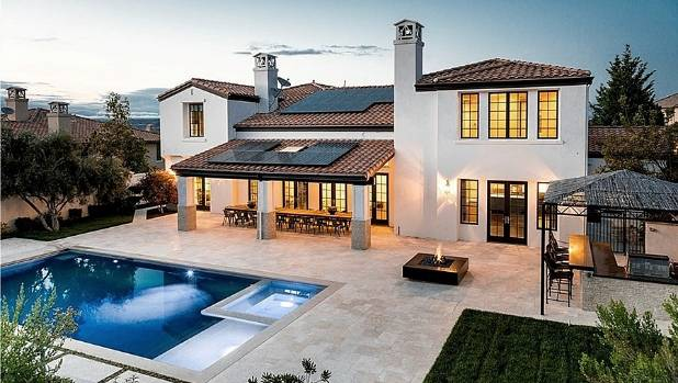 Kylie's backyard has all the expected California amenities: pool with spa, firepit, cabana-style bar and plenty of space ...