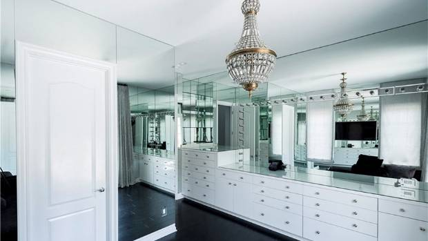 "This was once another en suite bedroom, but it's now a mirror-lined ""glam room""."