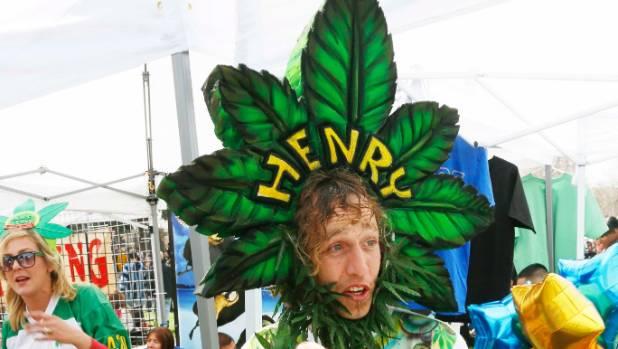 A man calling himself Henry Hemp works a vendor booth in Denver, Colorado.