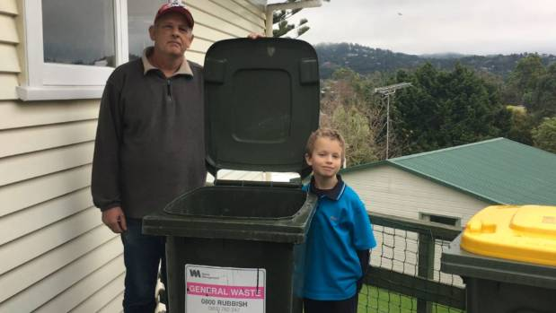 Paul Berg, left, says the 140l Waste Management rubbish bin is economical for his family. Son Christopher Berg, 7, says ...