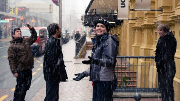 """Office workers on Lambton Quay enjoying the snow that fell across the city in an """"unprecedented"""" storm in 2011."""