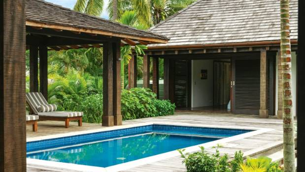 The small pool and loggia in the sheltered inner courtyard get a lot of use when it's windy out the front; pillars of ...