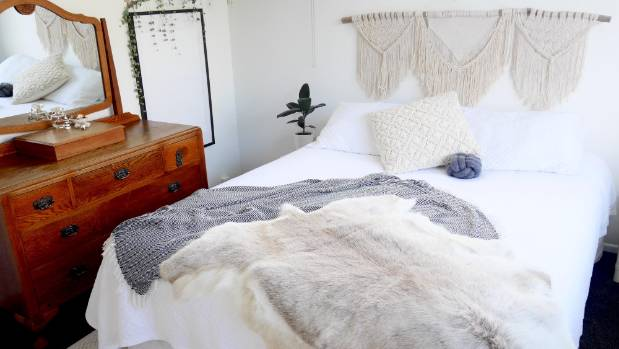 Jess says the couple love different wall hangings. The Bleubell Macrame bedhead in their master bedroom is a favourite.