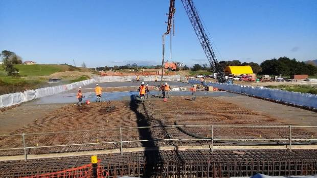 The Whangamaire Stream bridge deck pour required 95 trucks to bring in 520 cubic metres of concrete.