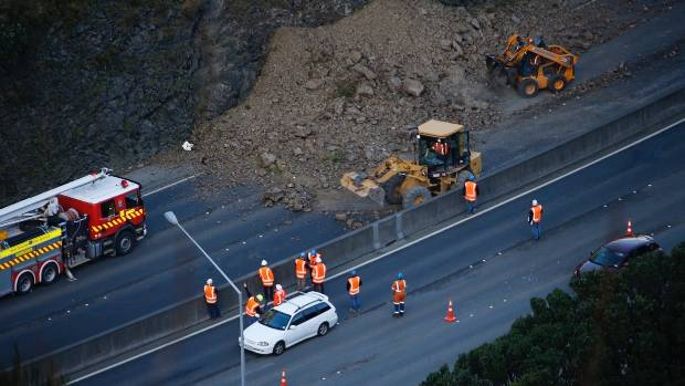 Two northbound lanes have been closed to allow contractors a chance to clean up the slip.