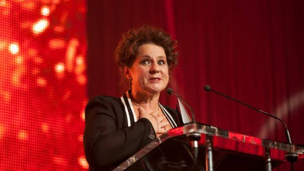 Last year's Women of Influence supreme winner Helen Robinson at the podium.