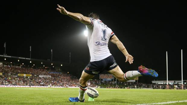 Michael Gordon of the Roosters lets fly with another successful kick for the Sydney Roosters.