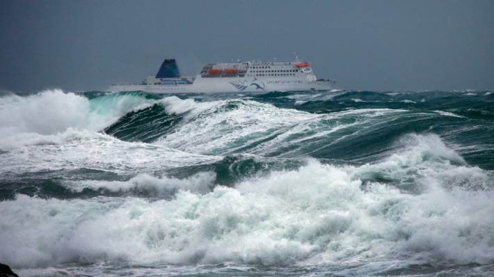 A Cook Strait ferry battles big waves out of Wellington.
