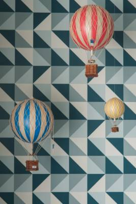 """""""This Remix wallpaper wouldn't typically be found in a nursery,"""" says Chaz. """"But it was the perfect choice for a room ..."""