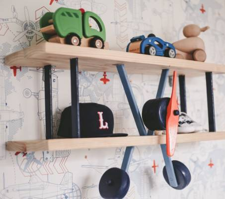This plane shelf is the perfect resting place for some wooden toy vehicles.