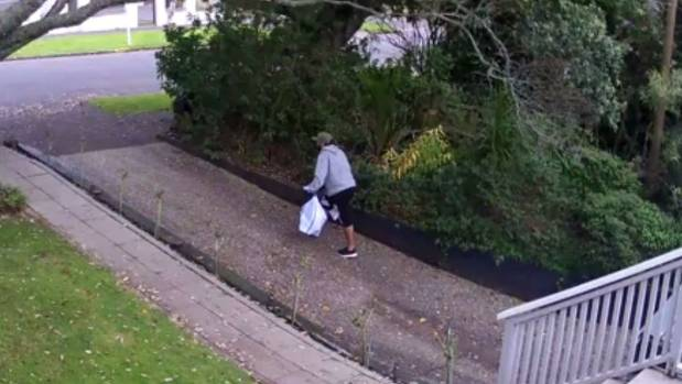 The man can be seen taking off down the driveway before hopping in his car and driving away.